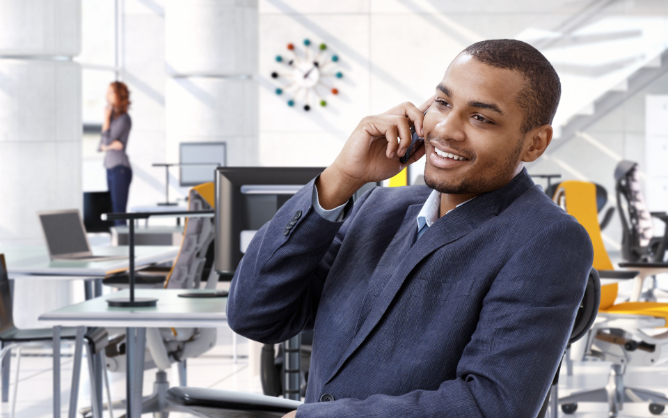 Afro american business advisor with mobile phone