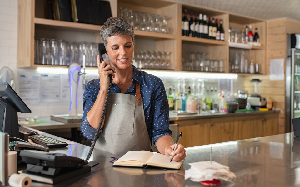 Coffee shop worker taking order over phone
